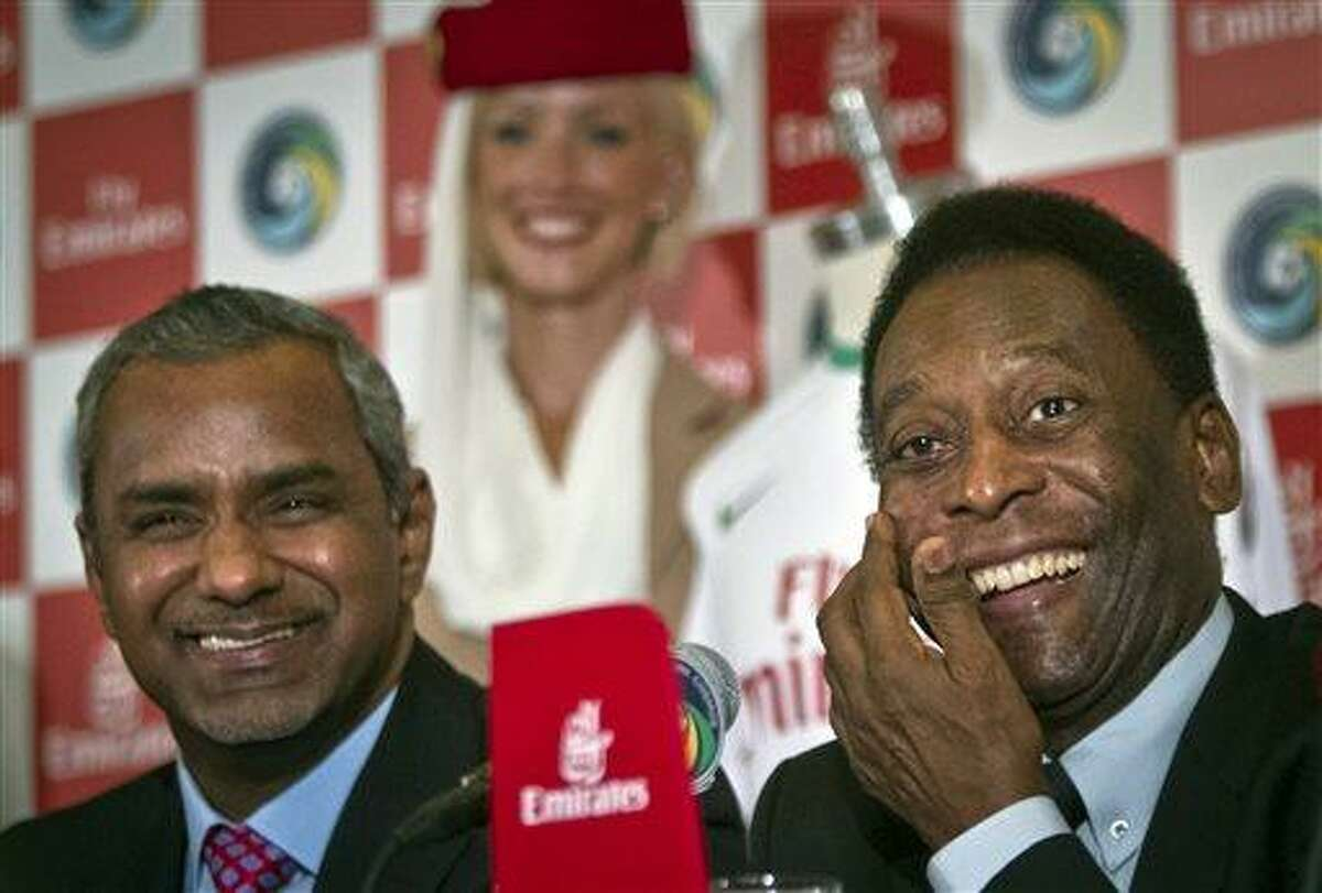 Brazil´s soccer legend Pele, right, and Nabil Sultan, vice president of Emirates Airline, smile during a press conference on Tuesday, June 4, 2013 in New York. Pele, 72, the honorary president of the New York Cosmos soccer club, appeared for the announcement that the revived team signed a sponsorship contract with Emirates Airline, as the team prepares to play in the North American Soccer League this summer. (AP Photo/Bebeto Matthews)