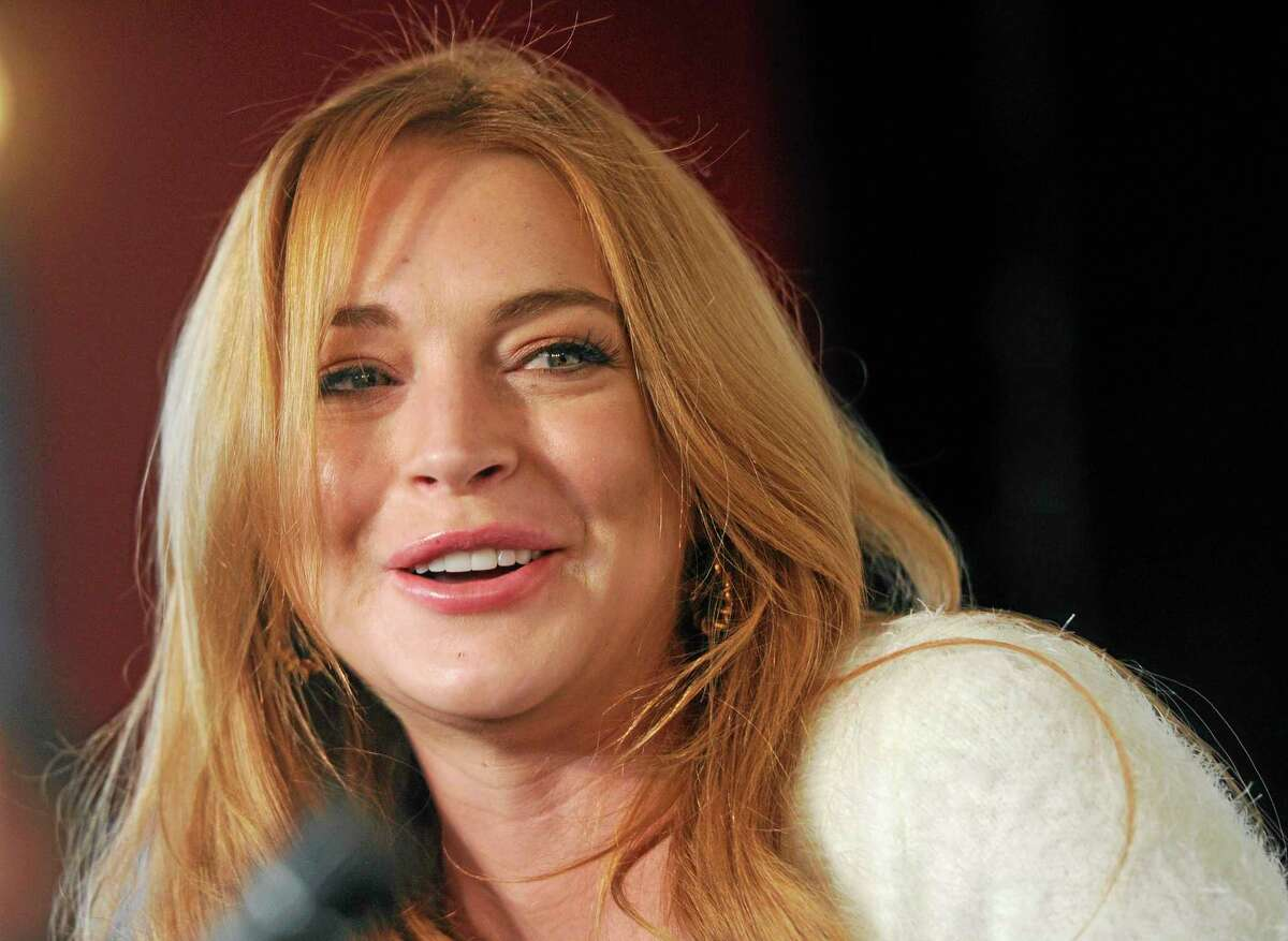 FILE - In this Jan. 20, 2014 file photo, actress Lindsay Lohan addresses reporters during a news conference at the 2014 Sundance Film Festival in Park City, Utah.