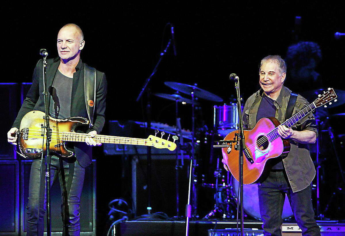 Sting and Paul Simon perform in their On Stage Together tour at The Palace of Auburn Hills, Wednesday, Feb. 26, 2014.