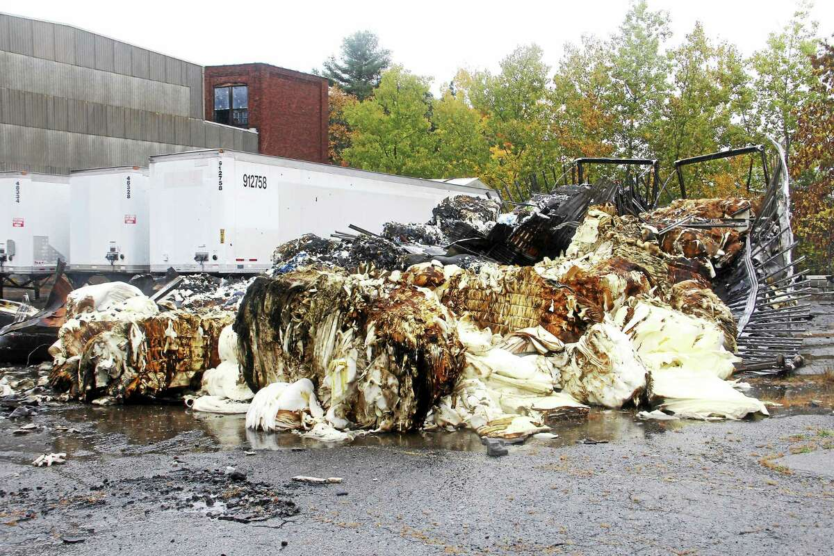 A pair of box trailers destroyed by a fire Thursday near Summer Street in Torrington. Authorities suspect the fire was arson.