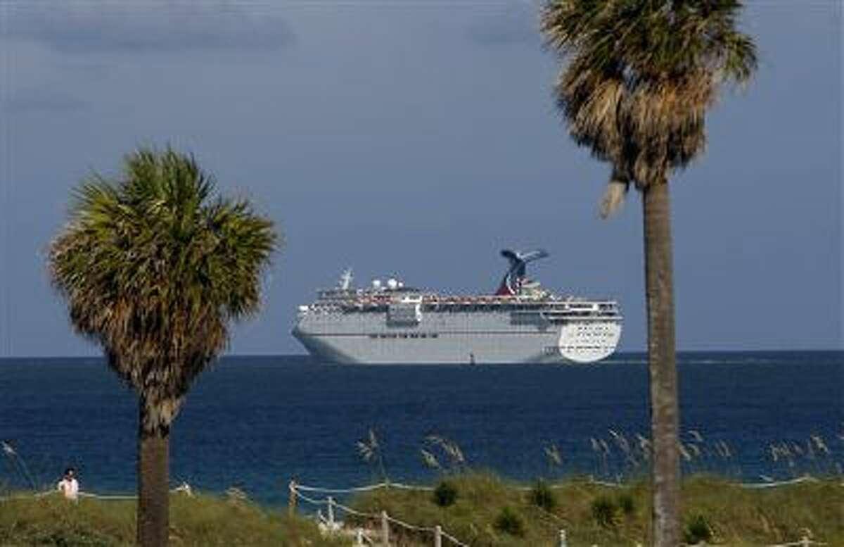 A cruise ship sails near Miami Beach, Fla., in August 2012.
