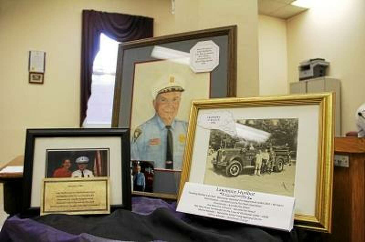 """A memorial for Lawrence P. """"Larry"""" Hurlbut, who served as the Winchester Volunteer Fire Department Fire Chief for more than 60 years, inside Town Hall in Winsted during a Board of Selectmen meeting on Tuesday, June 3, 2013. Hurlbut died on Sunday, and a memorial service is planned at the Winchester Center Green. (ESTEBAN L. HERNANDEZ/REGISTER CITIZEN)"""