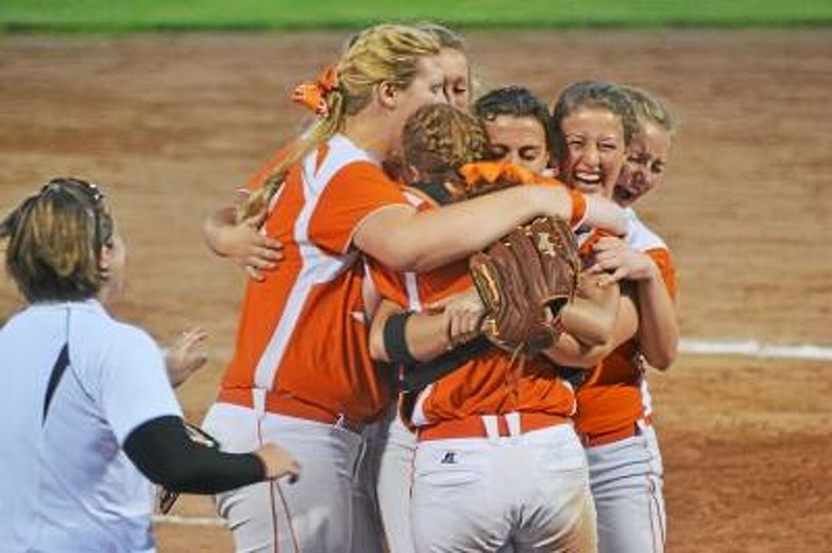 Pete Paguaga/Register Citizen Terryville's Jamie Bridge gets mobbed by her teammates after defeating Thomaston, 7-6 in the Class S semifinals.