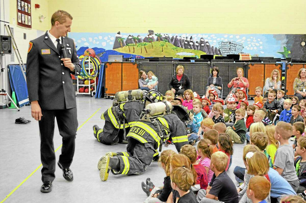 Kevin Ferrarotti, Public Education and Fire Prevention Officer, led a fire safety assembly at Harwinton Consolidated School with the help of firefighters on Thursday.