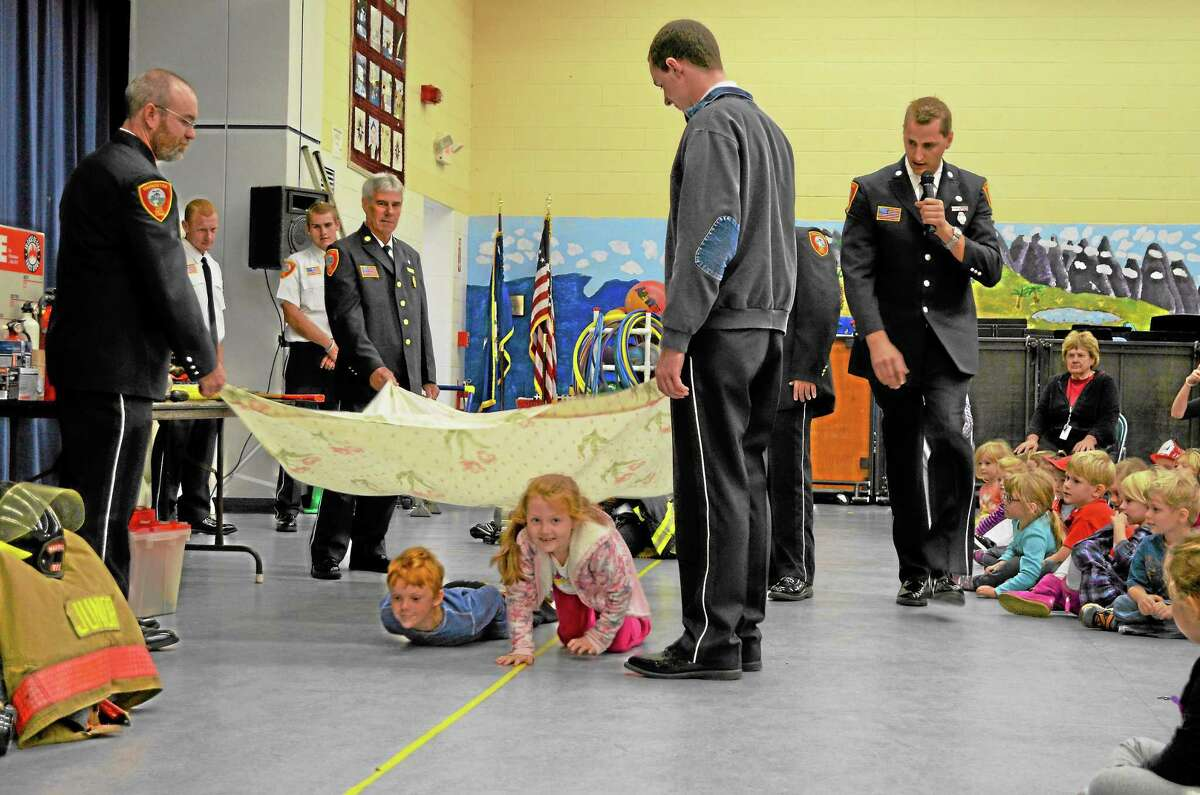 Students demonstrated fire safety practices at an assembly at the Harwinton Consolidated School, Thursday.
