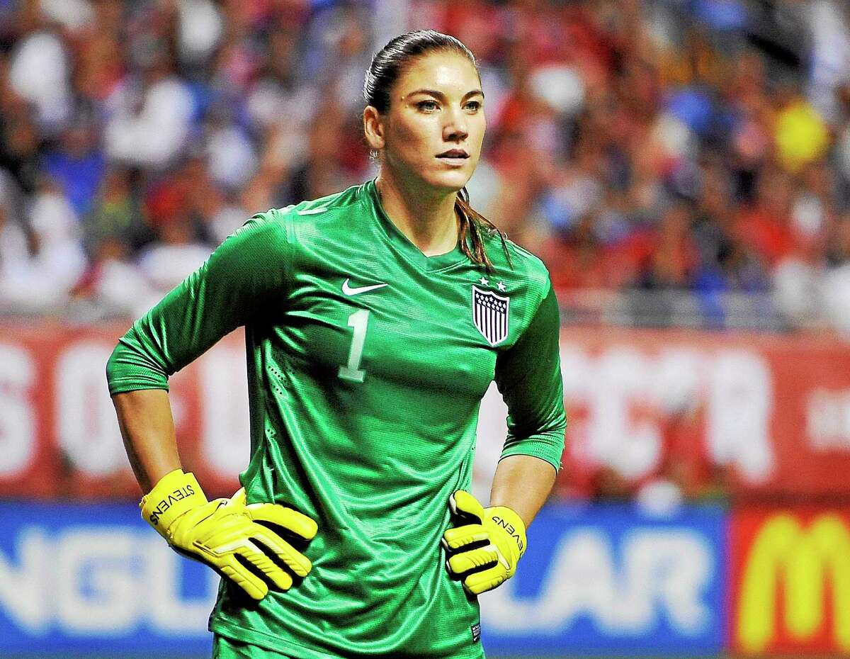 In this Oct. 20, 2013 photo, U.S. goalkeeper Hope Solo pauses on the field during the second half of an international friendly women's soccer match against Australia in San Antonio.