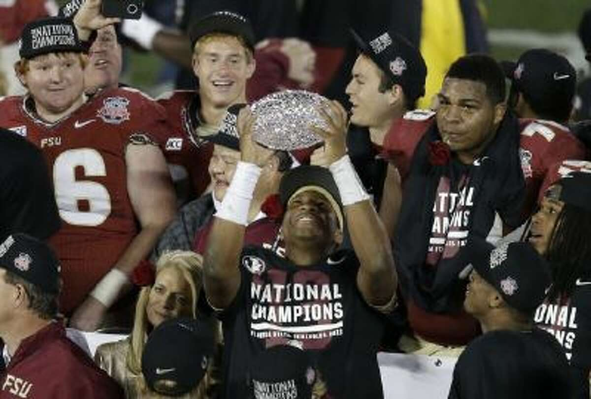Florida State's Jameis Winston celebrates with The Coaches' Trophy after Florida State beat Auburn in the BCS National Championship Game Monday in Pasadena.