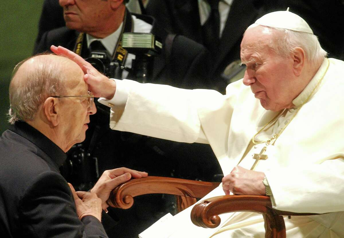 FILE - In this Nov. 30, 2004 file photo, Pope John Paul II blesses the late Father Marcial Maciel, founder of Christ's Legionaries, at a special audience for about 4,000 participants of the Regnum Christi movement at the Vatican. The troubled Legion of Christ religious order this week begins electing a new leadership.