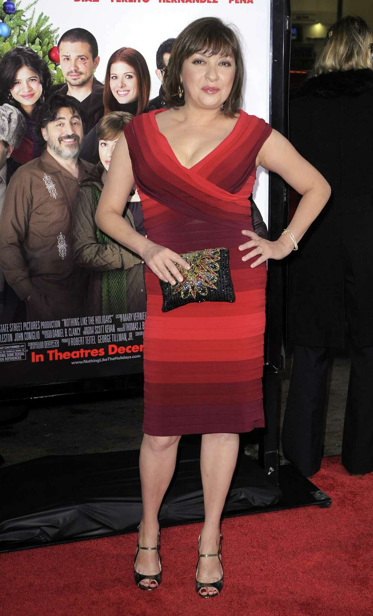 """FILE - In this Dec. 3, 2008 file photo, Elizabeth Pena poses as she arrives for the Los Angeles premiere of """"Nothing Like the Holidays,"""" in Los Angeles. The """"La Bamba"""" and """"Lone Star"""" actress Pena, 55, has died. Pena's manager, Gina Rugolo, said the actress died Tuesday, Oct. 14, 2014, in Los Angeles of natural causes after a brief illness. (AP Photo/Mark J. Terrill, file)"""