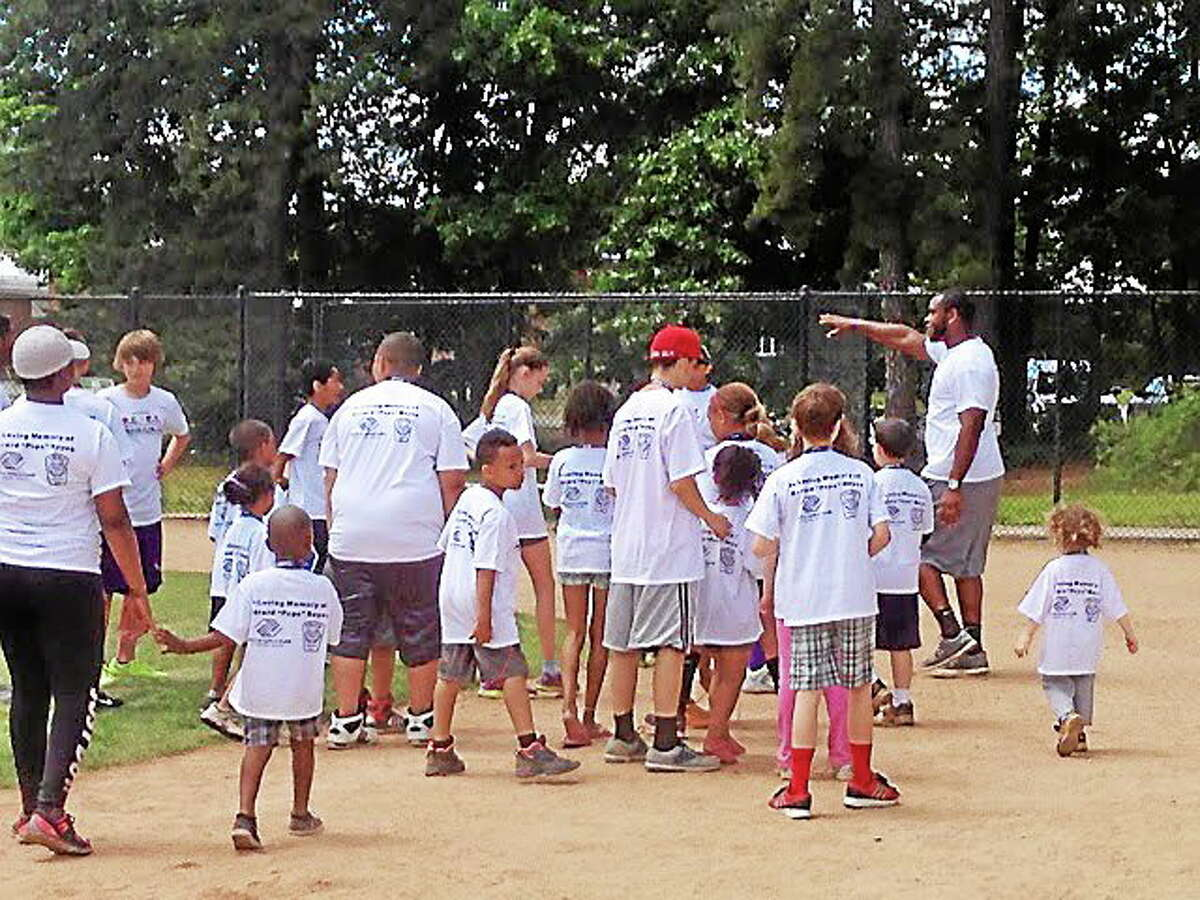 Former UConn star and current San Diego Chargers defensive end Kendall Reyes returned to his hometown of Nashua, N.H., to host his second R.E.Y.E.S Family Field Day.