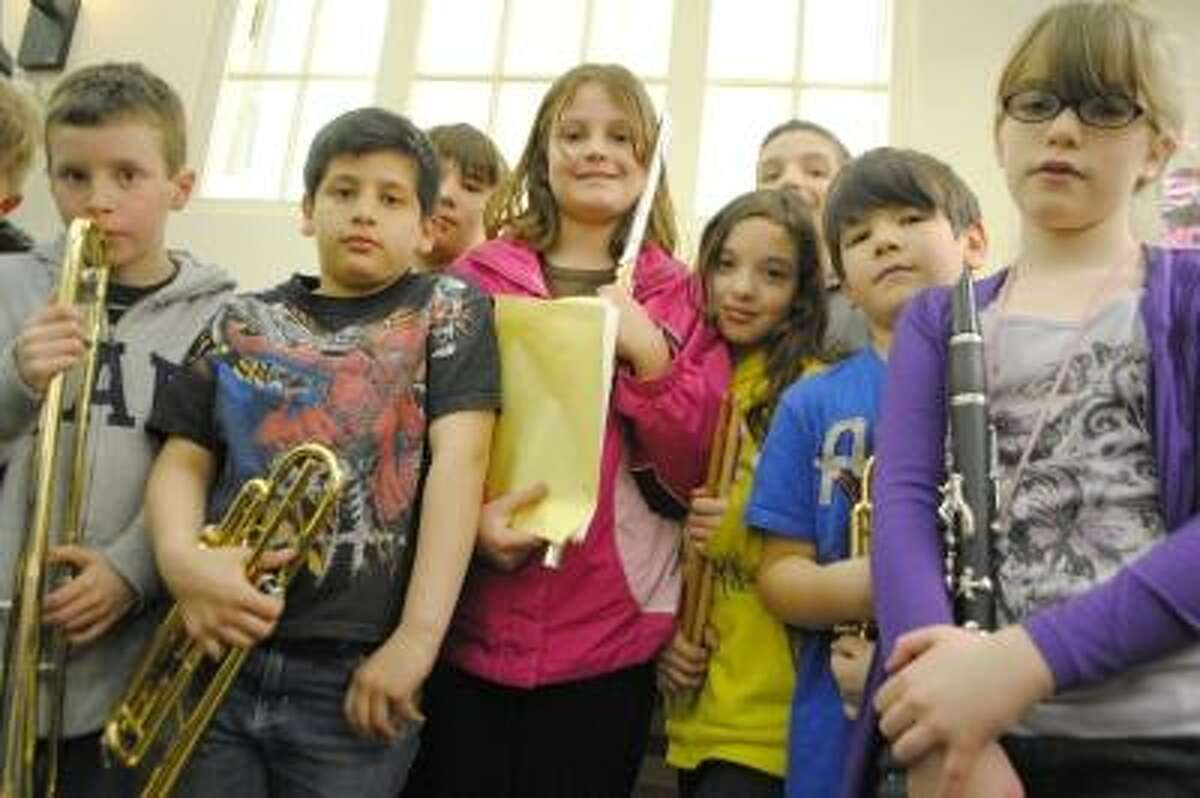 The Southwest Elementary School band member and student council president, Angel Blauvelt, in the center wearing pink, stands with other band members. Jessica Glenza/Register Citizen