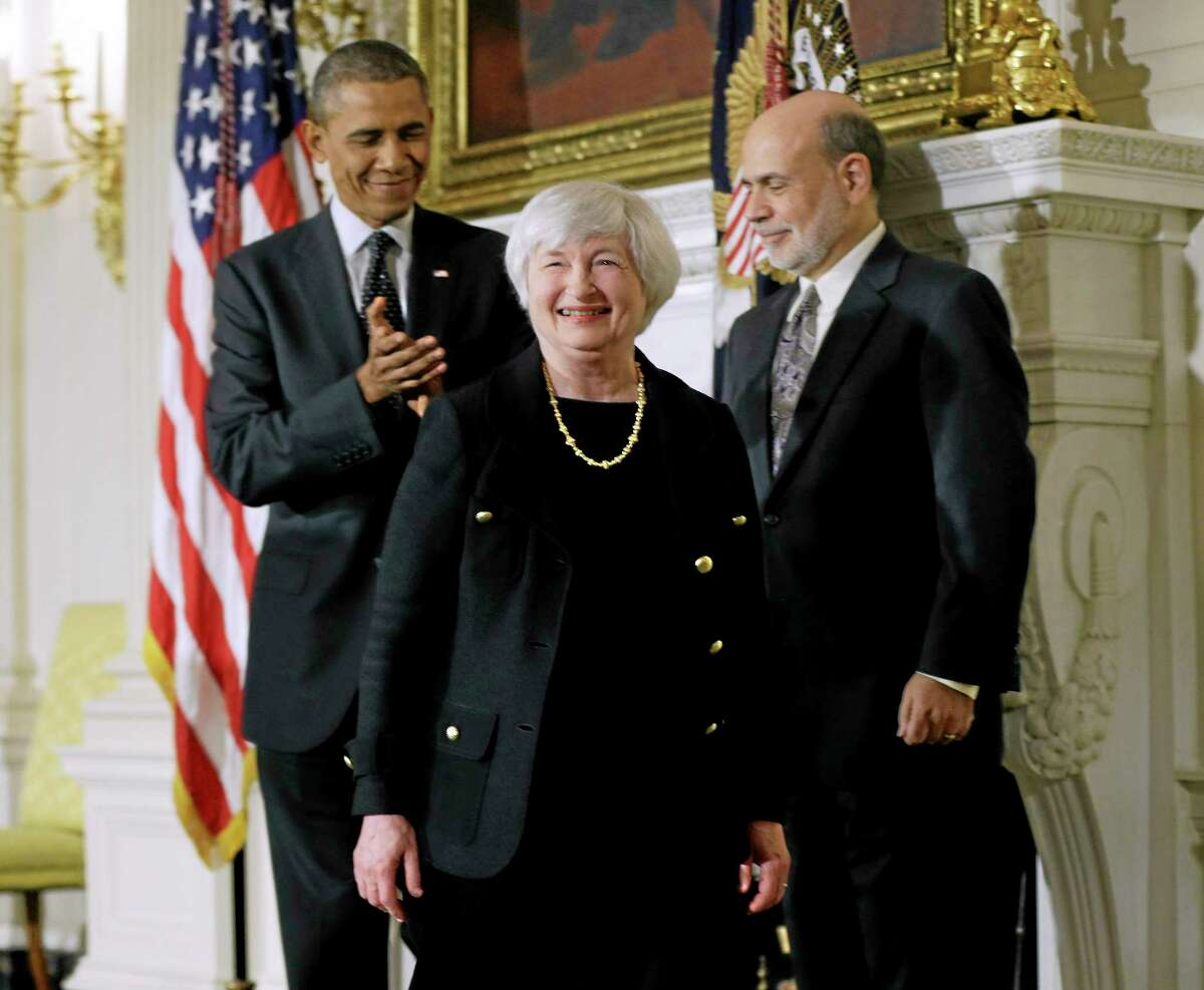 President Barack Obama and Federal Reserve chair Ben Bernanke join Janet Yellen, Obama's nominee to succeed Bernanke, at an announcement Wednesday, Oct. 9, 2013 in Washington. (AP Photo/Pablo Martinez Monsivais)