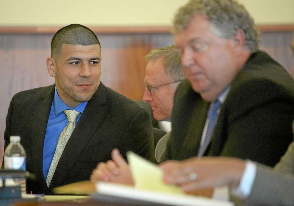 Former New England Patriots football player Aaron Hernandez, left, confers with his defense attorney during a recent hearing.