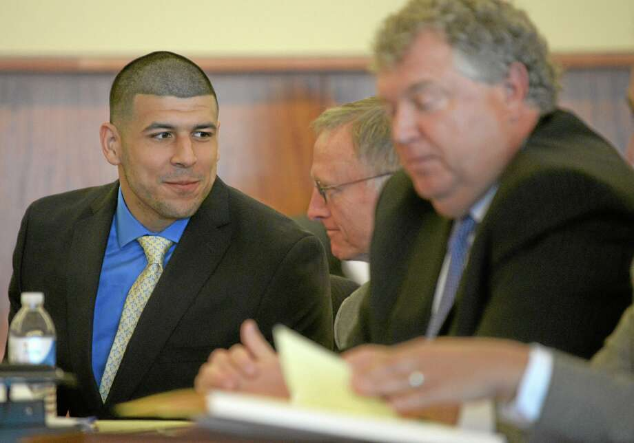 Former New England Patriots football player Aaron Hernandez, left, confers with his defense attorney during a recent hearing. Photo: The Associated Press  / Pool EPA