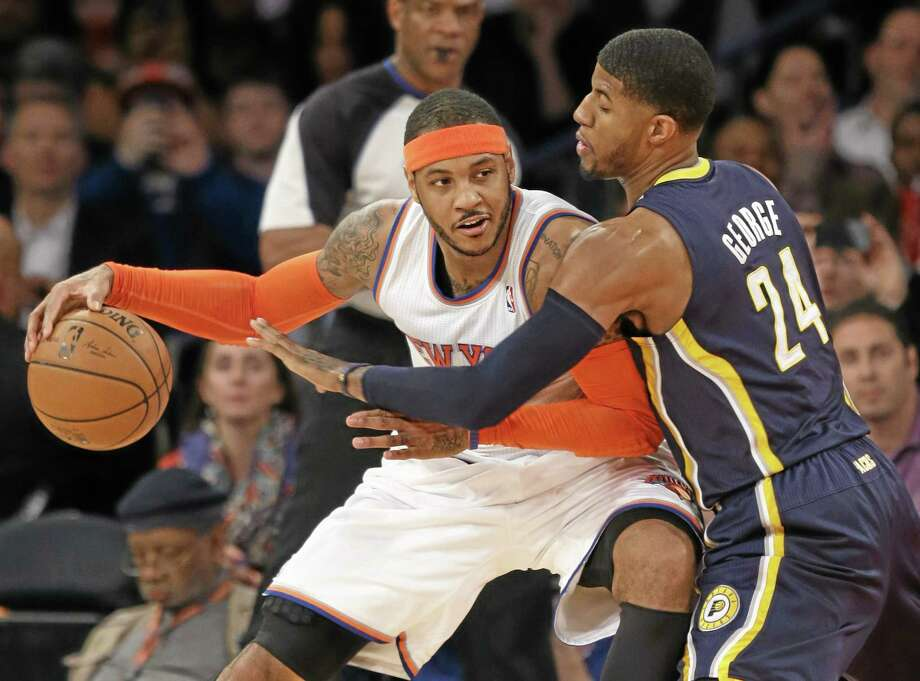 New York Knicks star Carmelo Anthony, left, is headed for free agency, according to sources. Photo: Seth Wenig — The Associated Press File Photo  / AP