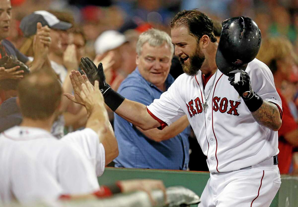 Red Sox first baseman Mike Napoli celebrates his solo home run during a July 19 game against the Kansas City Royals in Boston.
