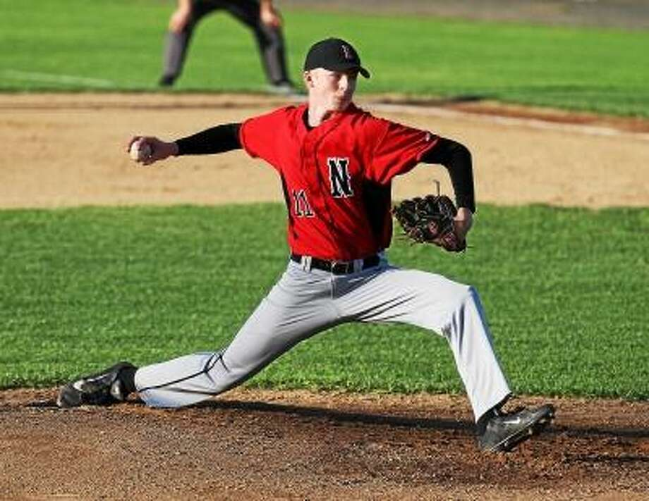 Marianne Killackey/Special to Register Citizen  Northwestern pitcher Jimi Phillips winds up in his team's win over Holy Cross Tuesday night. / 2013