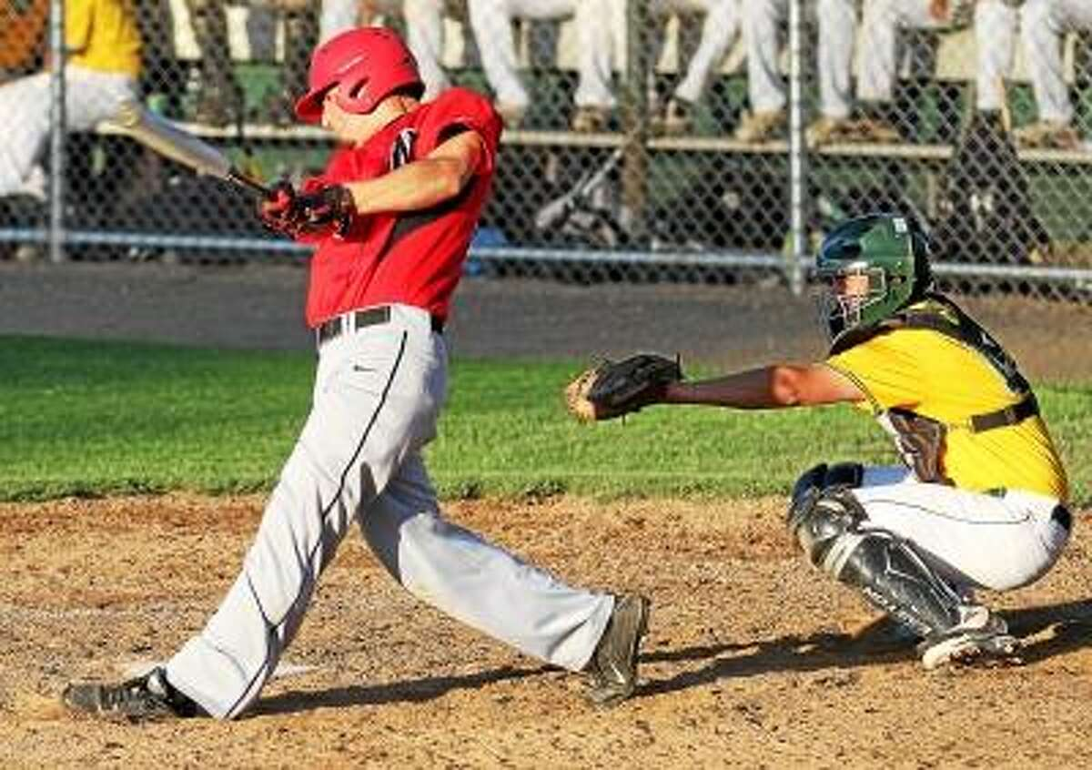 Marianne Killackey/Special to Register Citizen Mike Jeffko of Northwestern connects for a double in his team's win Tuesday night at Beehive Field in New Britain.