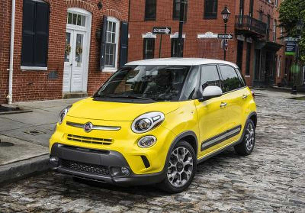 This undated image made available by Chrysler shows the 2014 Fiat 500L.
