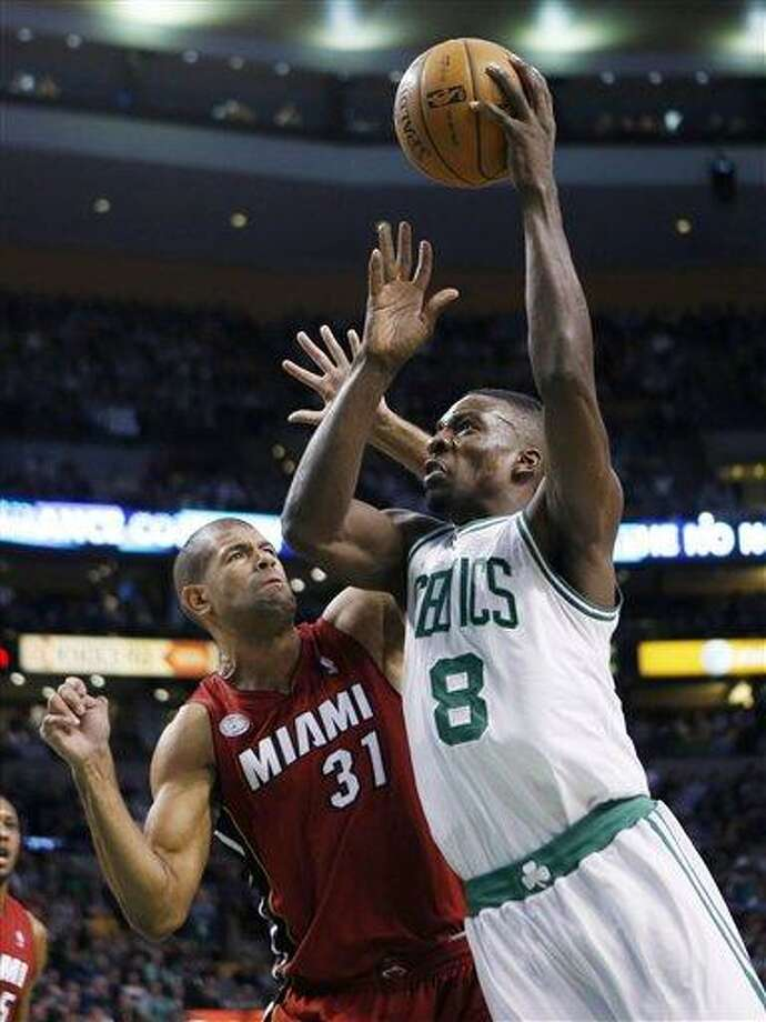 Boston Celtics' Jeff Green (8) shoots over Miami Heat's Shane Battier (31) in the first quarter of an NBA basketball game in Boston, Monday, March 18, 2013. (AP Photo/Michael Dwyer) Photo: ASSOCIATED PRESS / AP2013