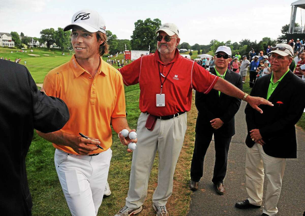 (Mara Lavitt ó New Haven Register) June 22, 2014 Cromwell The final round of the 2014 Travelers Championship golf at the TPC River Highlands in Cromwell. Kevin Streelman won with a score of 15-under. Aaron Baddeley finishes the course. mlavitt@newhavenregister.com