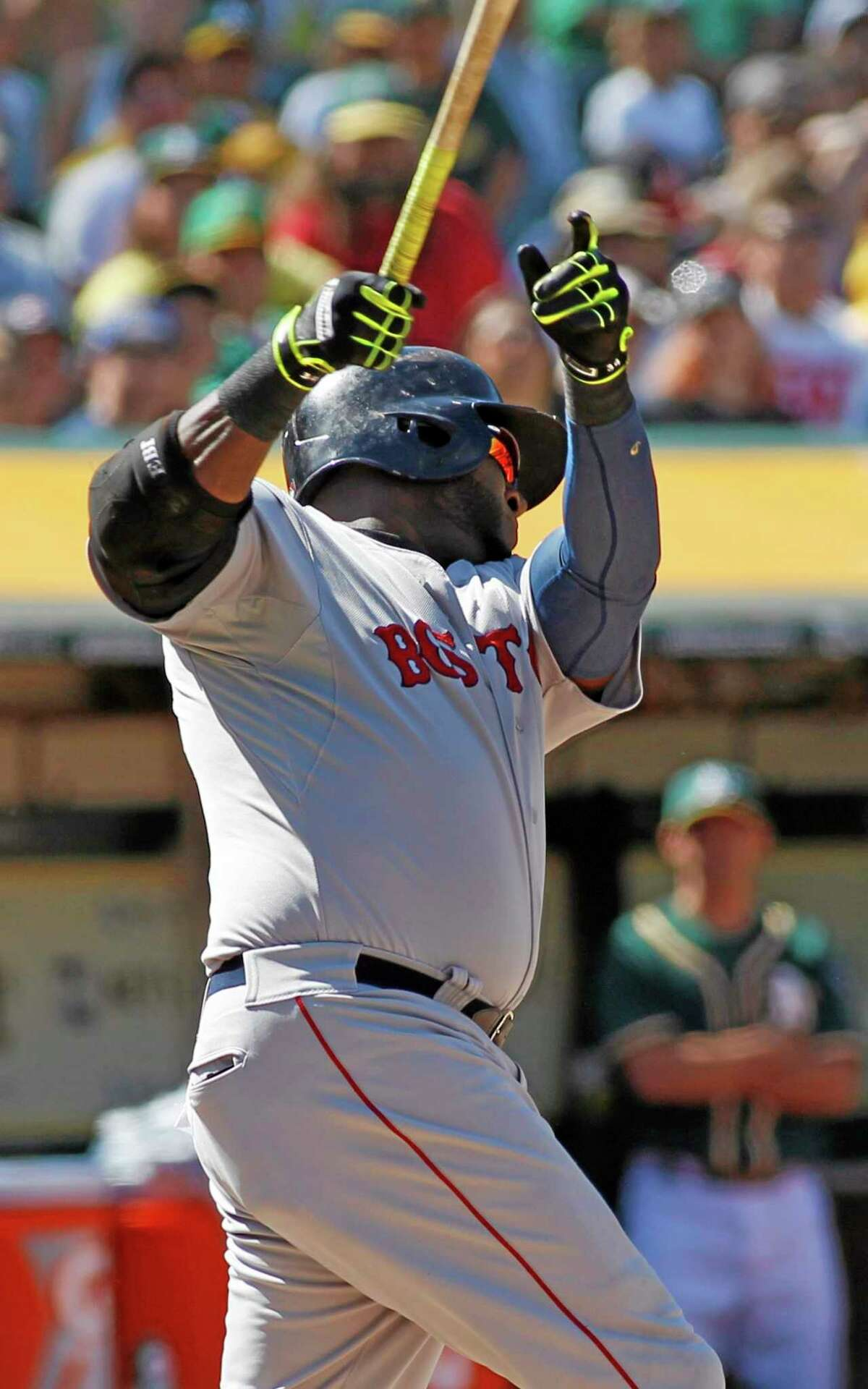 Boston designated hitter David Ortiz hits a game-winning home run against the Athletics during the tenth inning of the Red Sox's 7-6 win on Sunday in Oakland, Calif.
