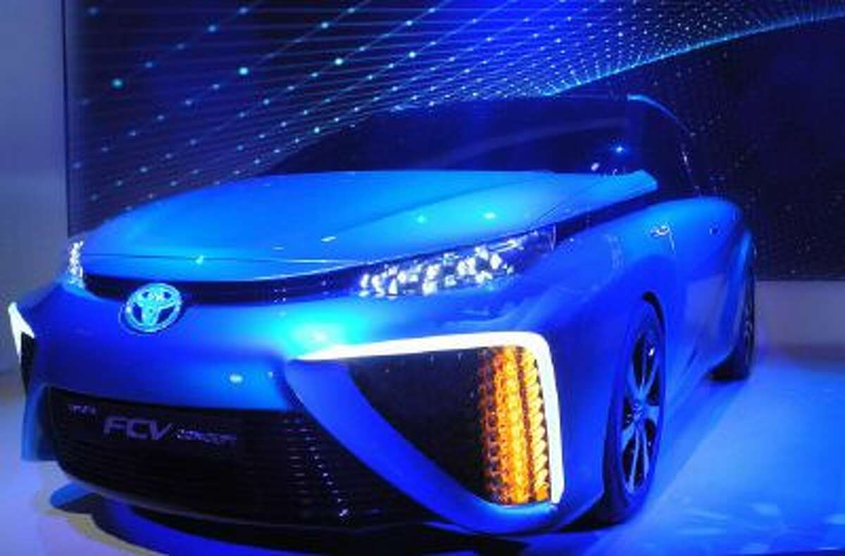 """Toyota's hydrogen fuel cell car is seen at a press conference at 2014 International CES, Jan. 6, 2014 in Las Vegas. Toyota said it plans to launch the yet to be named fuel-cell car in the United States next year, declaring the hydrogen vehicle with zero emissions """"the car of the future."""""""