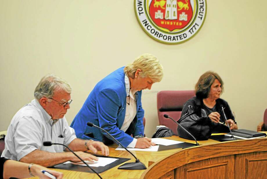 Winchester Selectmen (from left) George Closson and Candy Perez, and Winchester Mayor Maryann Welcome, voted to bring acceptance of a $2.5 million loan to voters. Photo: Jessica Glenza—Register Citizen