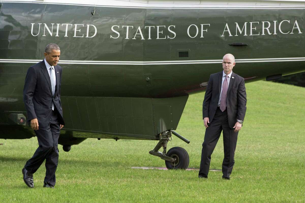 President Barack Obama walks from Marine One on the South Lawn of the White House in Washington on Oct. 14, 2014.