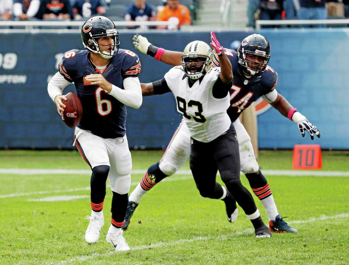 Bears quarterback Jay Cutler scrambles against New Orleans Saints outside linebacker Junior Galette during the second half on Sunday in Chicago.