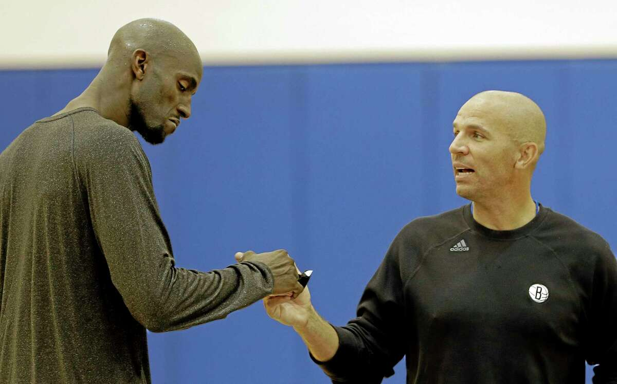 The Brooklyn Nets' Kevin Garnett, left, shakes hands with head coach Jason Kidd during the team's training camp last week at Duke University in Durham, N.C.