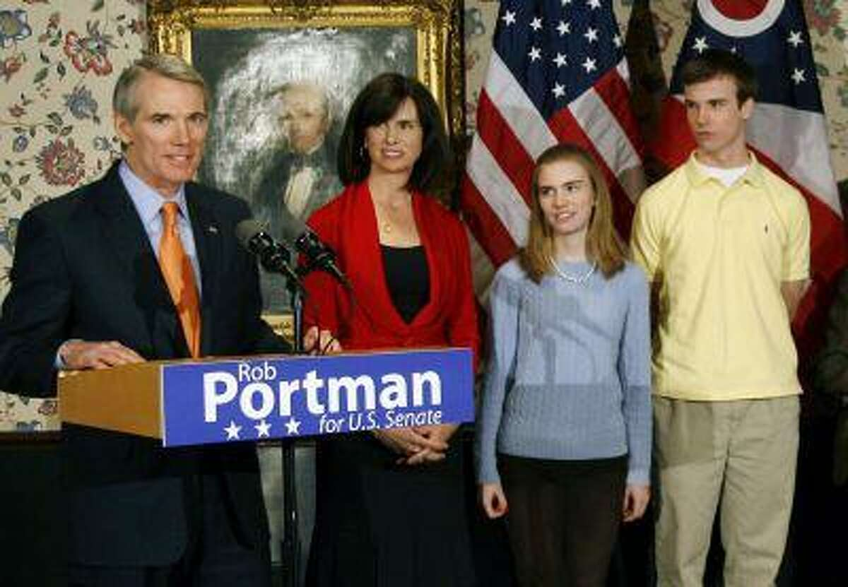 In this Wednesday, Jan. 14, 2009 photo, U.S. Sen. Rob Portman, from left, with his wife, Jane, daughter Sally, and son Will, stands after announcing that he will run for the U.S. Senate, in Lebanon, Ohio. Portman is now supporting gay marriage and says his reversal on the issue began when he learned his son Will is gay. (AP Photo/David Kohl)
