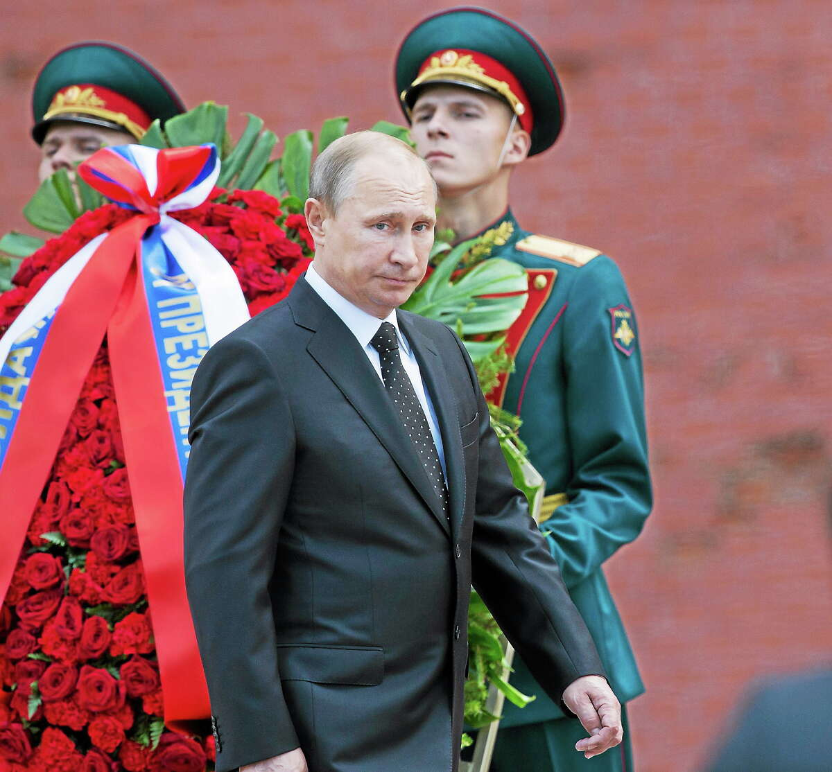 Russian President Vladimir Putin takes part in a wreath laying ceremony at the Tomb of the Unknown Soldier outside Moscow's Kremlin Wall, in Moscow, Russia on June 22, 2014 to mark the 73rd anniversary of the Nazi invasion of the Soviet Union.