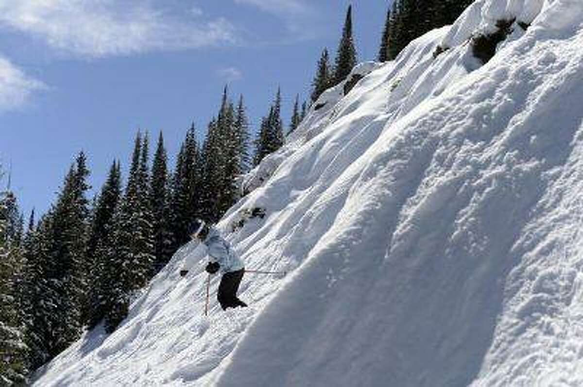 Kara Shay, above, of Kentucky heads down a steep face of the Prima Cornice run at Vail Mountain on Wednesday. (Andy Cross, The Denver Post)