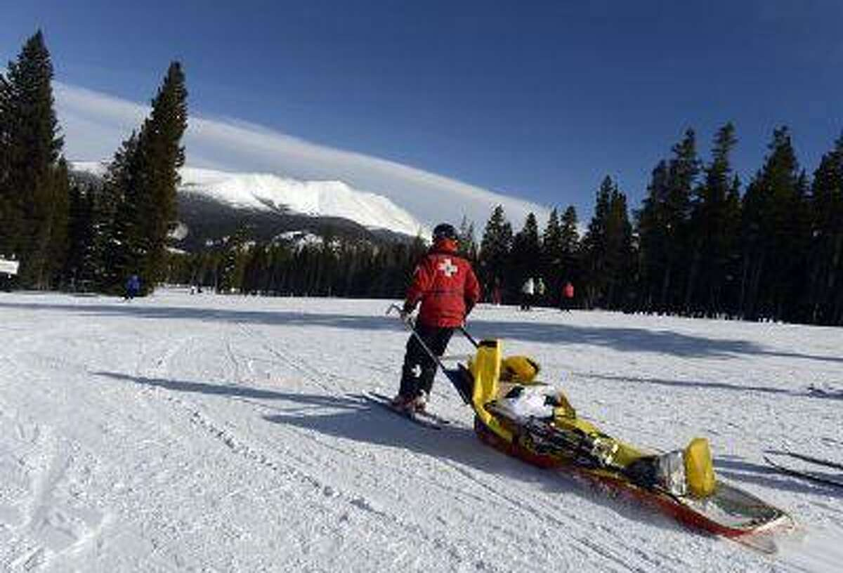 Jeff Hankins, a ski patroller with the Breckenridge resort, takes an injured skier to a medical center this month. Ski areas consider ski-patrol and employee reports to be proprietary information. (Andy Cross, The Denver Post)