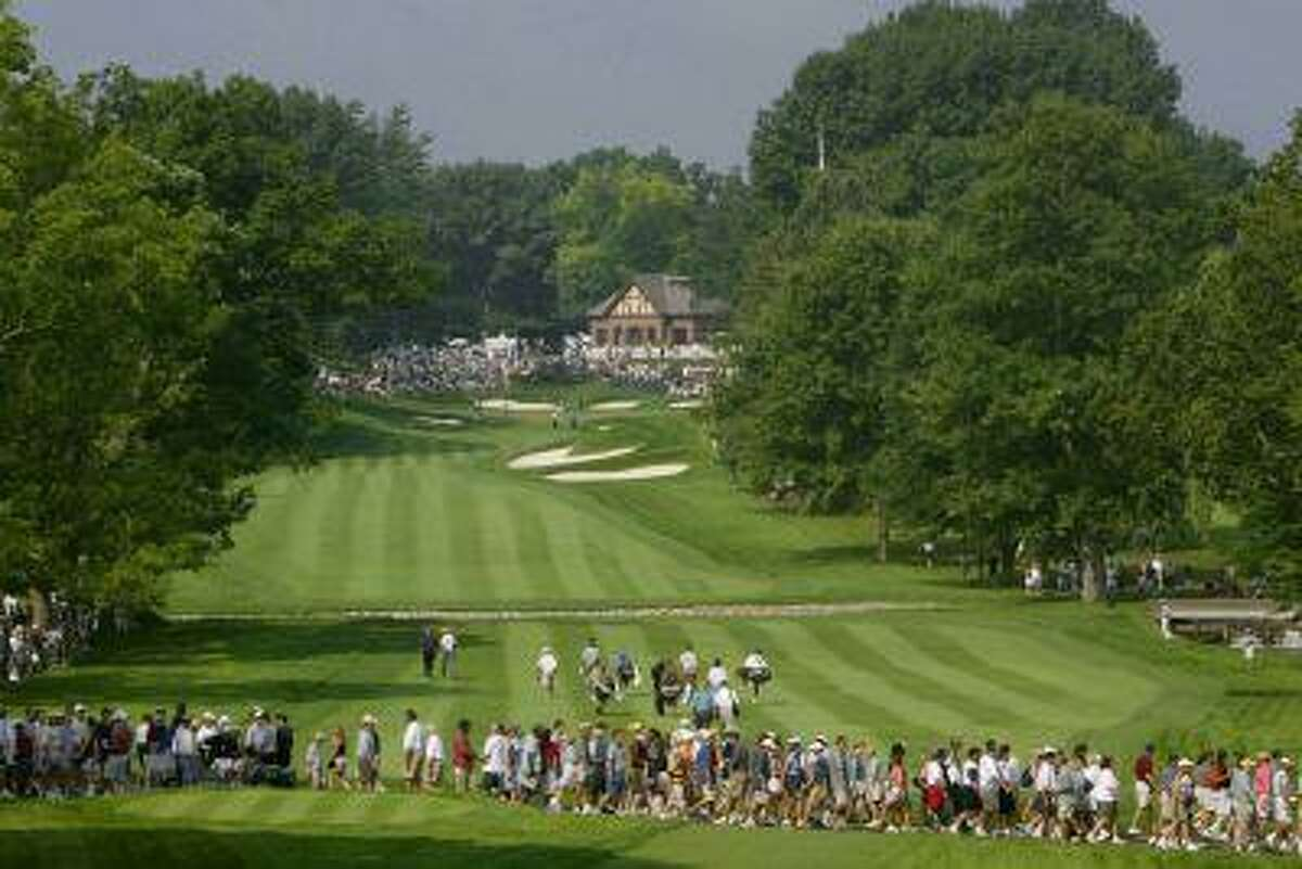 Spectators cross the 13th fairway looking up to the clubhouse on the 13th green during the 85th PGA Championship in Rochester, N.Y., known for the city's top-ranked golf courses. (Reuters/Kevin Lamarque)