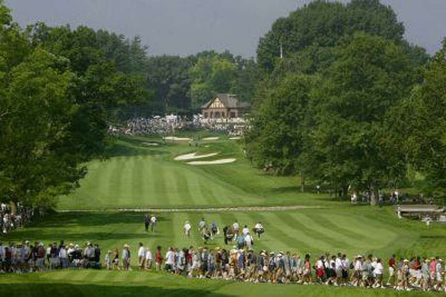Spectators cross the 13th fairway looking up to the clubhouse on the 13th green during the 85th PGA Championship in Rochester, N.Y., known for the city's top-ranked golf courses. (Reuters/Kevin Lamarque) Photo: REUTERS / X00157