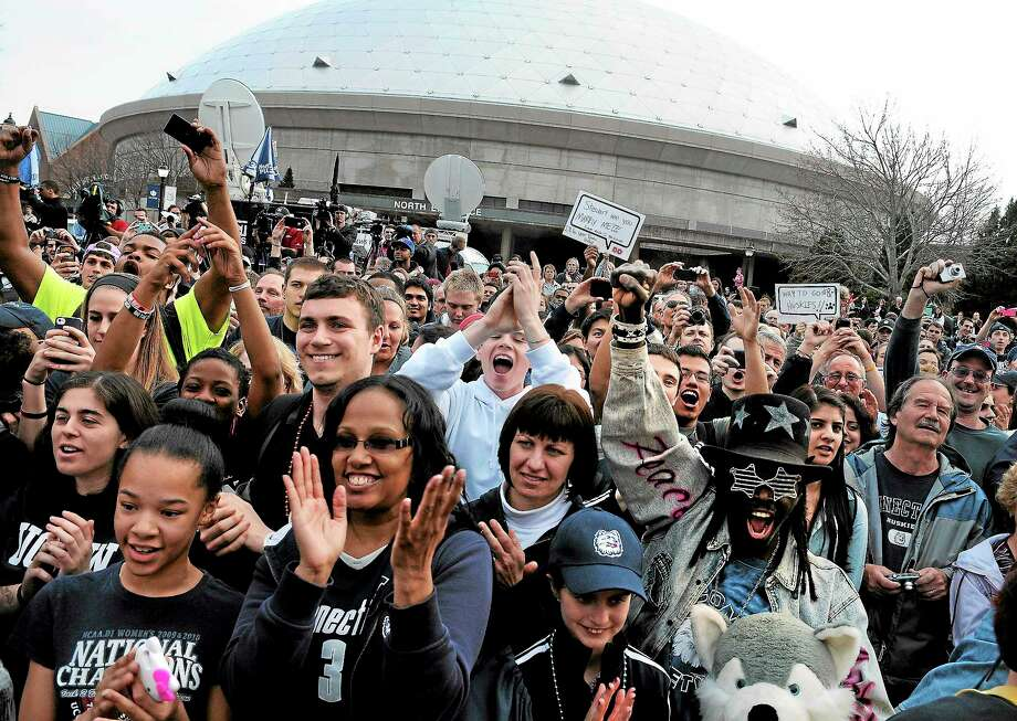 Fans cheer outside Gampel Pavilion during a rally and parade through the Storrs campus honoring the UConn women's basketball team's win in the NCAA tournament on April 10. Photo: Jessica Hill — The Associated Press  / FR125654 AP