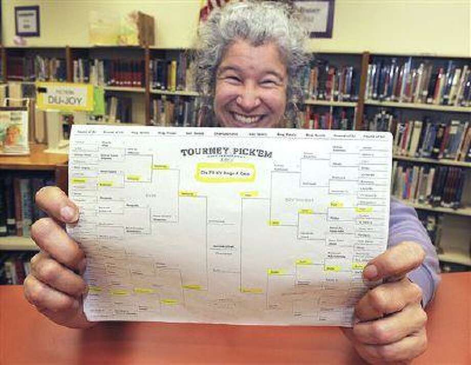"""Jefferson (Ore.) High School librarian Diana Inch displays her winning NCAA tournament bracket from <a href=""""http://Yahoo.com"""">Yahoo.com</a>'s online contest in 2011. The odds of completing the perfect bracket by picking the higher-seeded team are 35 billion to 1. We look at alternative formats. Photo: AP / Albany Democrat-Herald"""