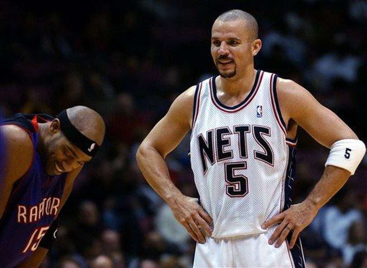FILE - In this Dec. 6, 2004 file photo, New Jersey Nets' Jason Kidd (5) talks with Toronto Raptors' Vince Carter during the second quarter of an NBA game in East Rutherford, N.J. The New York Knicks say Kidd has decided to retire from the NBA after 19 seasons. His retirement Monday, June 3, 2013, comes two days after fellow 40-year-old Grant Hill, with whom Kidd shared Rookie of the Year honors in 1995, announced his retirement. (AP Photo/Bill Kostroun, File)