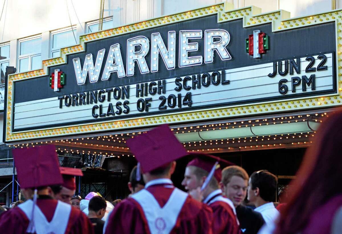 Tom Caprood - The Register Citizen Graduates gather on Main Street following Torrington High School's 2014 commencement ceremony Sunday at the Warner Theatre.
