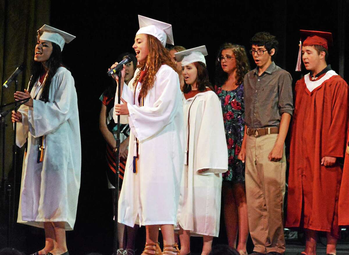 Tom Caprood - The Register Citizen Graduates perform during Torrington High School's 2014 commencement ceremony Sunday at the Warner Theatre.
