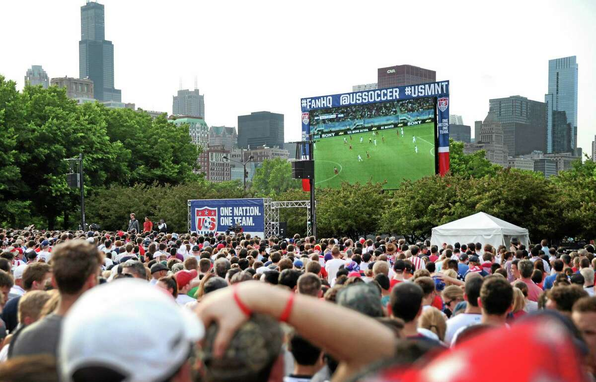Fans watch as the United States Men's National Team faces off against Ghana in their World Cup match at a viewing party in Grant Park in Chicago on Monday.