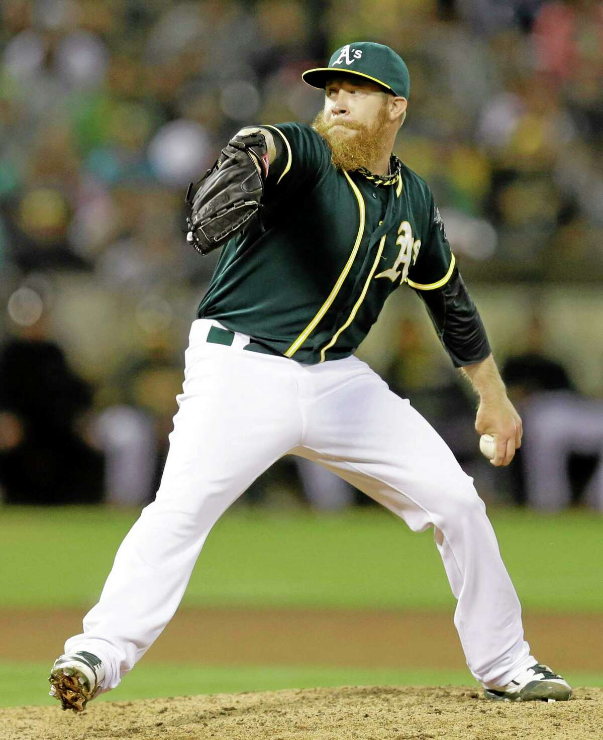 Oakland Athletics closer Sean Doolittle works against the New York Yankees in the ninth inning of a June 14 game in Oakland, Calif.