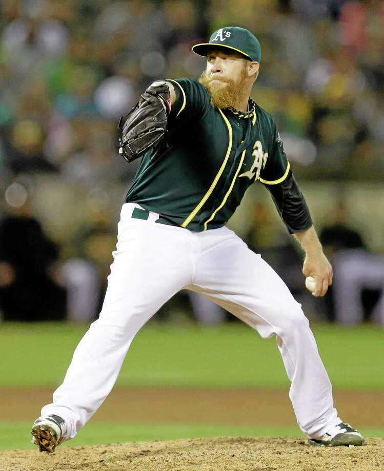 Oakland Athletics closer Sean Doolittle works against the New York Yankees in the ninth inning of a June 14 game in Oakland, Calif. Photo: Ben Margot — The Associated Press  / AP