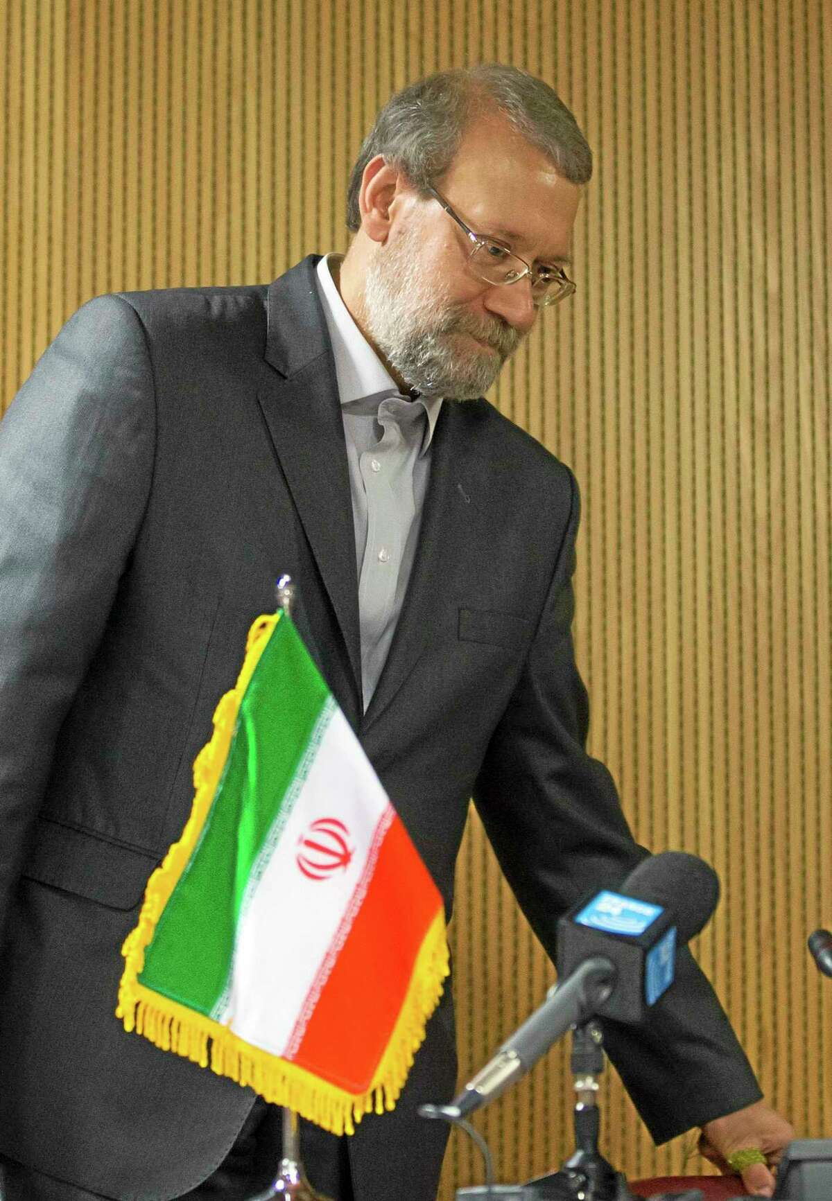 Iran's Parliament speaker Ali Larijani arrives for a press conference on the sidelines of the 129th Assembly of the Inter-Parliamentary Union (IPU), in Geneva, Switzerland, Wednesday, Oct. 9, 2013. (AP Photo/Keystone, Salvatore Di Nolfi)
