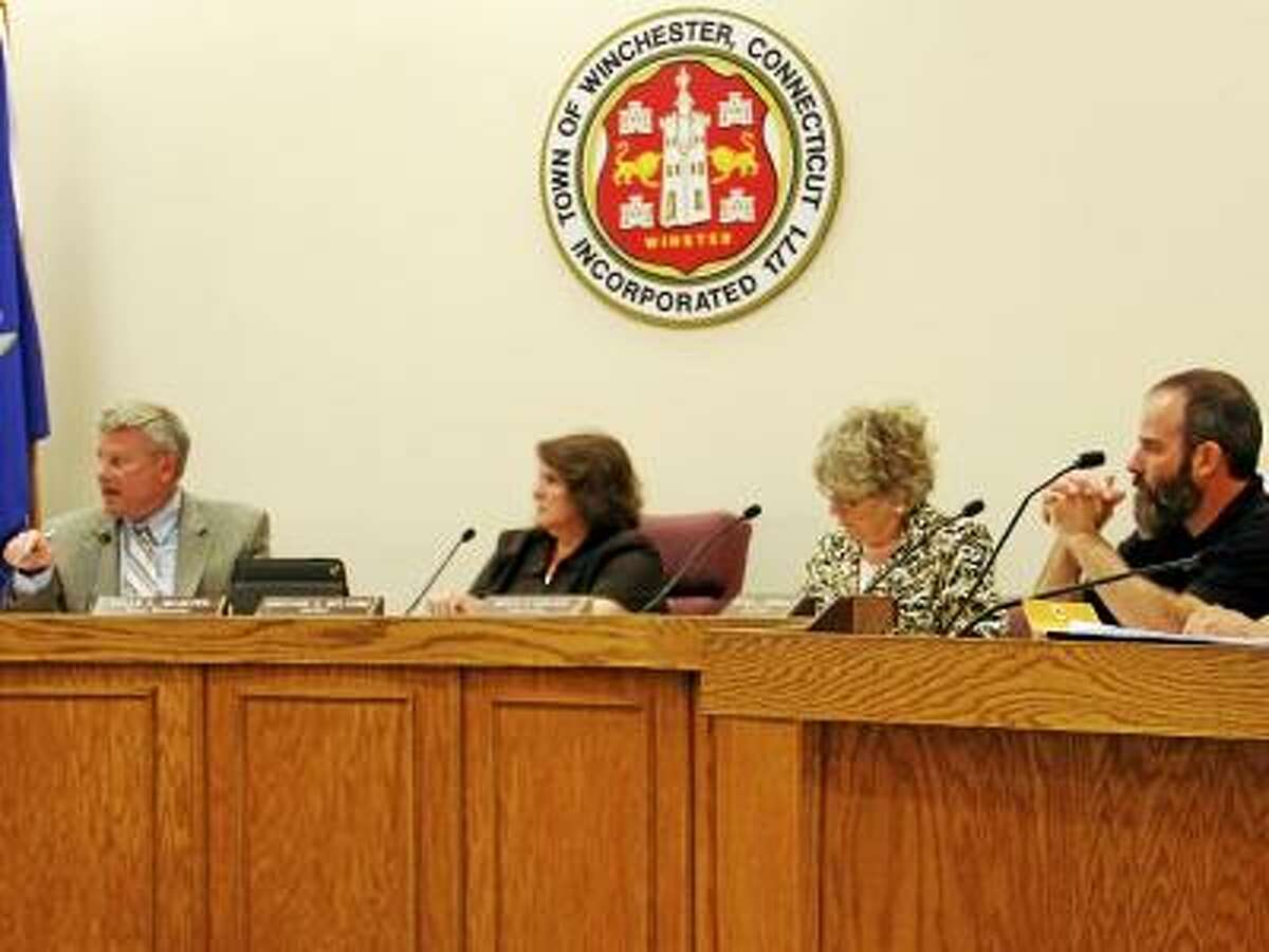 ESTEBAN L. HERNANDEZ/REGISTER CITIZEN - Members of the Winsted Town Government listen to Town Manager Dale Martin, second from left, during a Board of Selectmen meeting on Monday, June 3.