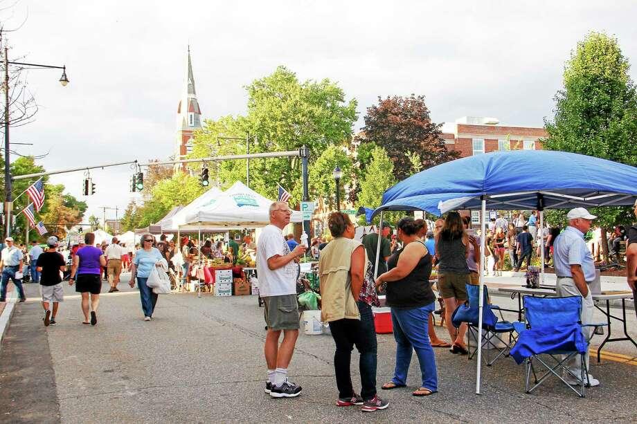 Crowds packed Torrington's Main Street for the final Main Street Marketplace of the summer season in August. Photo: Esteban L. Hernandez — File — The Register Citizen