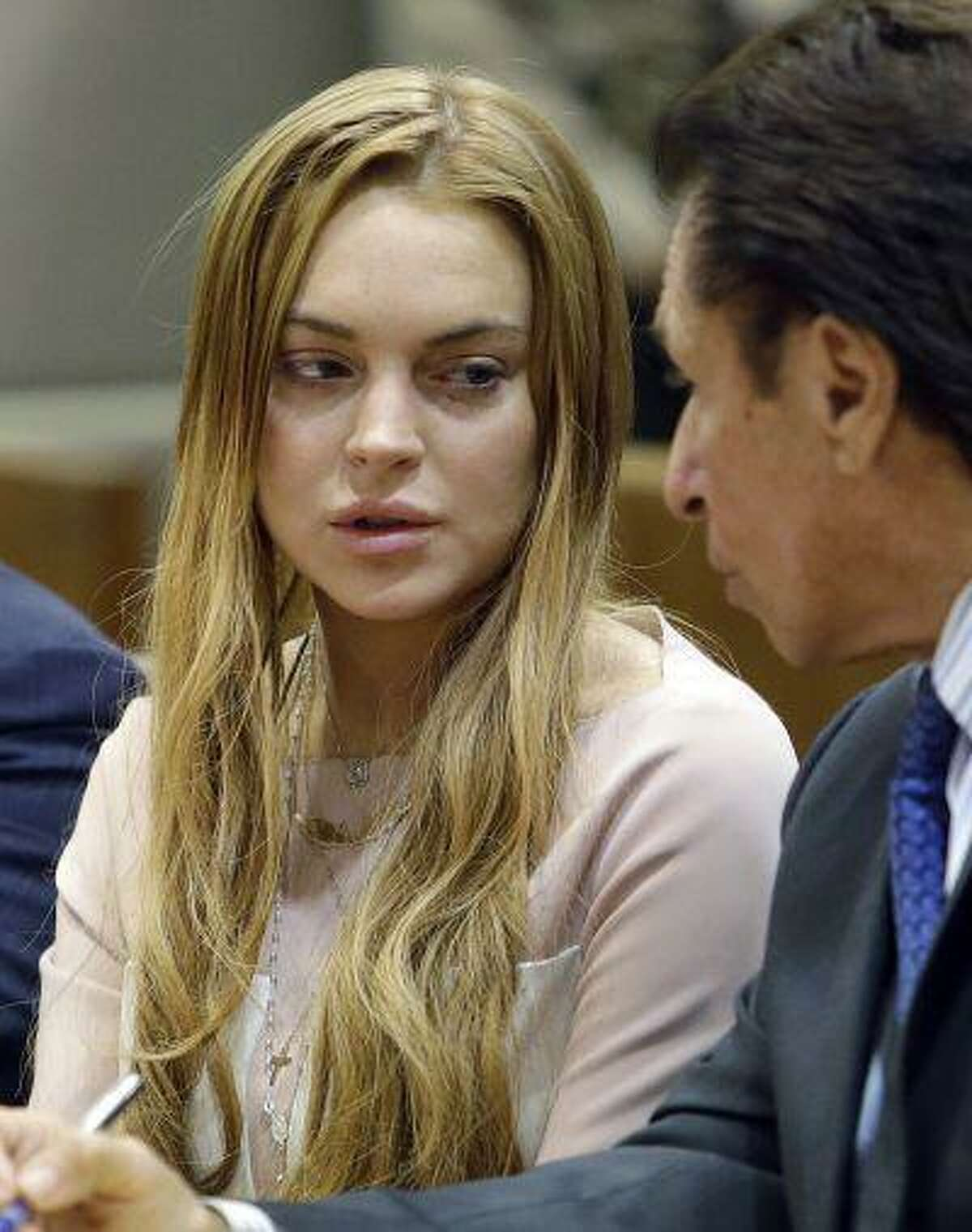 Actress Lindsay Lohan and attorney Mark Heller appear at a hearing in Los Angeles Superior Court Monday, March 18, 2013. Lohan accepted a plea deal on Monday in a misdemeanor car crash case that includes 90 days in a rehabilitation facility. The actress, who has struggled for years with legal problems, pleaded no contest to reckless driving, lying to police and obstructing officers who were investigating the accident involving the actress in June. (AP Photo/Reed Saxon, Pool)