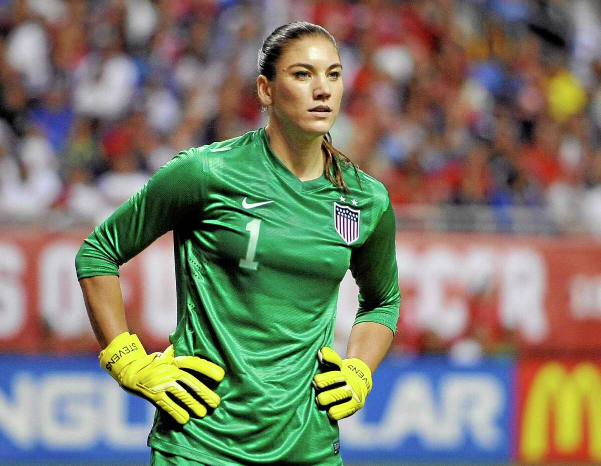 In this Oct. 20, 2013 file photo, United States goalkeeper Hope Solo pauses on the field during the second half of an international friendly against Australia in San Antonio. Police say Solo was arrested early Saturday at a suburban Seattle home for assaulting her sister and nephew.